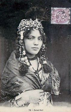 Africa | Ouled Nail woman. Post stamped 1909. Notice the spikes on her bracelet…