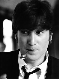 John Lennon by Astrid Kirchherr, during the filming of A hard day's night movie, 1964, somewhere in southern England.