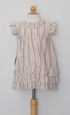 $84 This stripe dress from Blue Pony Vintage features a triple ruffle hem and ruffle sleeves. The big skirt feature and coconut buttons give this dress a beachy boho vibe that you can't resist.
