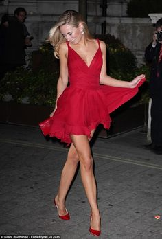 Flawless figure: The blonde beauty seemed to be having a fantastic time at the event playing with her dress