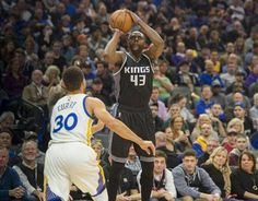 Sacramento Kings forward Anthony Tolliver hits a 3-pointer against Golden State Warriors guard Stephen Curry (30) during their game at Golden 1 Center in Sacramento, Calif., on Sunday, Jan. 8, 2017.