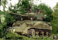 An Sherman tank named 'Elowee' of 'E' Company, Armored Regiment, Armored Division is parked near a hedge in Champ du Boult, Calvados, Normandy on August Image Avion, Patton Tank, Us Armor, Sherman Tank, Military Armor, Military Photos, Military Memes, Armored Fighting Vehicle, Military Modelling