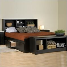 This is a platform bed with a book case headboard, extra storage underneath, and a bed end bench. Me want.