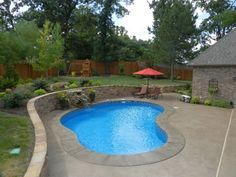 kidney shape pool in small yard
