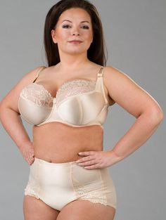 Ewa Michalak Bibi Bezowa BM Bra: the correct bra will make clothes fit better. No unsightly skin smooshing. This color is good for a light skinned person. Wear a color similar to your skin tone under white shirts. White bras can seen under white shirts, which is not a good business look.