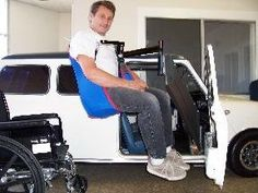 Image of a large man preparing to use Port-A-Lift to enter a very small car.