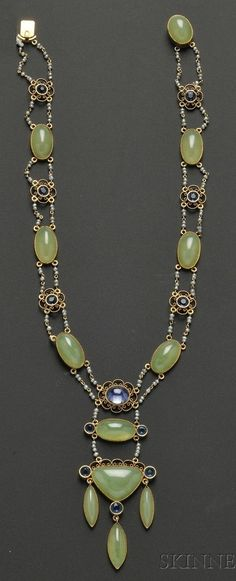 Arts & Crafts 14kt Gold and Serpentine Necklace, set with shaped and oval cabochons, with cabochon sapphire accent, quatrefoil motifs centring blue stones, and joined by seed pearls. #ArtsAndCrafts #necklace