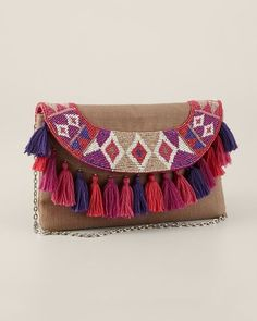 the tassels are sewn to the body of the purse, not to the flap