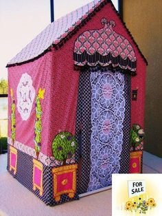 My friend Karen makes these sweet playhouses. She made L.E. one several years ago in her signature colors of pink and green. It is fantastic!  Karen is so creative and talented. She will totally customize one for your needs. I'm thinking big top circus or zoo house for little boys (@Tahna Neilson)!