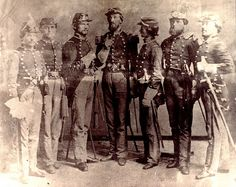 Pictured is Captain Carsten Nohrden (1827-1861), who served in the Columbia Battery of the German Artillery, standing center (with right index finger pointed) flanked by other officers of Charleston's German Artillery. His German Artillery officer's sword, c. 1861 (pictured within this Pin Board) can be seen at his left hip. Charleston Museum.