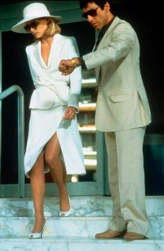 michelle pfeiffer as elvira hancock and al pacino as tony montana in scarface, brian de palma Michelle Pfeiffer Scarface, Elvira Hancock, Mode Collage, Photo Vintage, White Suits, White Skirt Suit, White Pantsuit, White Dress, Green Dress