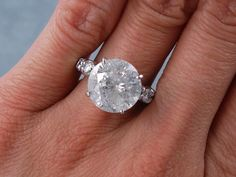 4.40 ctw Radiant Cut Diamond Engagement Ring. It has an inviting ...