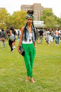The 13 Best Looks From Afropunk Fest #refinery29  http://www.refinery29.com/2014/08/73448/afropunk-street-style#slide10  Shakeera Bacon, a model and stylist, selected a more comfortable look with green drop-crotch pants, a white tank, and a classic denim vest.
