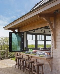 An Indoor-Outdoor Serving Bar Opens the Possibilities...future lake house!