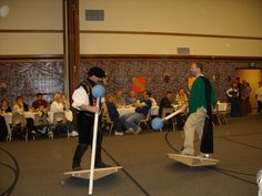 Jousting at Medieval Feast activity. Plywood circles for the platforms. Jousting stick is pvc pipe with a nerf ball glued on, covered with fabric gray taped to the pvc pipe.