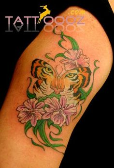 Vibrant tiger butterfly tattoos on bodies # this tiger butterfly is made on women arm # its made by green # blue # orange # pink colours of ink # it looks lovely # pretty indeed # For more visit http://tattoooz.com
