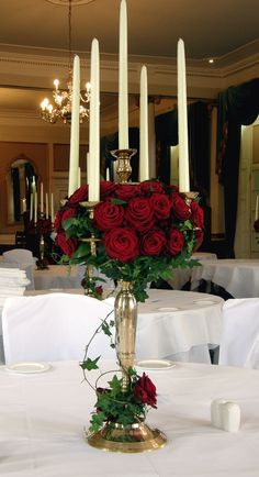 Red roses and candles: perfect element for a decoration Wedding Reception Flowers, Red Wedding, Wedding Table, Candelabra Wedding Centerpieces, Wedding Decorations, Centrepieces, Beauty And The Beast Party, Christmas Wedding, Wedding Designs