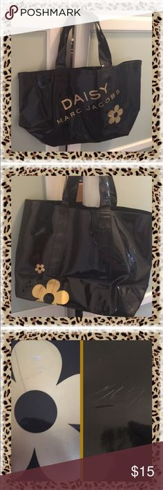 """👜Authentic Marc Jacobs Bag👜 PVC Material, authentic Marc Jacobs Daisy tote. Has been folded up in my closet. NEVER USED!!  Pristine except for scratches on daisy and part of the bag. Open top - no zipper or any type of closure. Perfect for the beach or trip to grocery store. Drop handle 7"""". Marc by Marc Jacobs Bags Totes"""