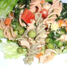 This salmon pasta salad uses brown rice pasta in place of the traditional variety. It is then tossed in a vinaigrette dressing and a colorful array of vegetables to make a flavorful, quick meal.