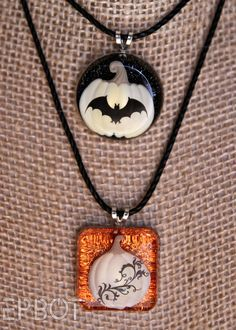 Resin jewelry made with scrapbook stickers!