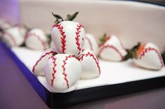 clever dessert decor - strawberries covered in white chocolate and decorated in red icing to look like baseballs - photo by Houston based wedding photographer Adam Nyholt
