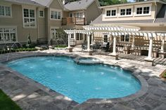 Oakville.  Square cut flagstone  and a traditional white interior finish complement this classic roman design. (P74)