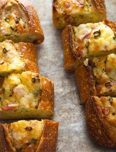 baked egg boats  http://spoonforkbacon.com/2012/01/baked-egg-boats/