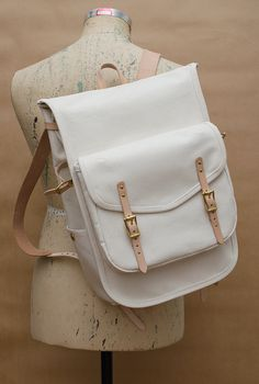 White leather with gold embellishments & tan straps. I love this combo of colors but i would probably get this dirty fast Backpack Bags, Leather Backpack, Leather Bag, Tote Bag, White Leather, Mochila Adidas, Thigh Bag, Cute Backpacks, Fabric Bags