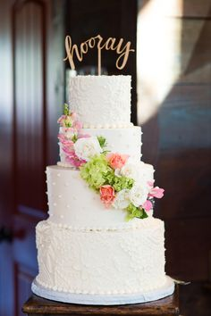 Three Tier White Swiss-Dot and Lace Piping Wedding Cake with Pink Floral Accents |  REBECCA ELLISON PHOTOGRAPHY | http://knot.ly/6493BFErL