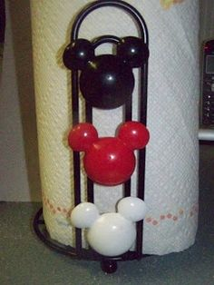 Mickey Mouse Paper Towel Holder for the kitchen- made from a cheap paper towel holder and shower curtain rings.  Less than five dollars! {This would be a cute idea to do in the kids bathroom maybe a month or so before the Disney vacation to get them even more amped up!}