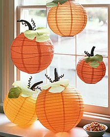 Halloween pumpkin lanterns: Take a paper lantern, dress it up with leaves, a stem, and tendrils. Download and enlarge the Leaf Template as desired; cut out, and trace onto green paper. Cut out.2. With white craft glue, attach a dark-green pipe cleaner to the leaf's center. For curly tendrils, spiral two brown pipe cleaners.