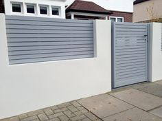 front boundary wall screen automated electronic gate installation grey wooden fence bike store modern garden design balham clapham london (4)