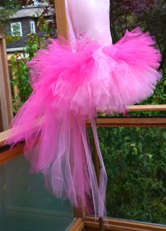 Pink Fluffy Flamingo Tutu Super full, super beautiful, super fun!!! Handmade with lots and lots of gorgeous tulle and ribbon. very