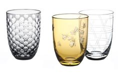 Theresienthal Planet Earth: Bees, Beehive, Honeycomb: Bees are the object of affection on tumblers in the Planet Earth series. Mouthblown tumblers are made with two layers of glass; clear on the inside and a very thin tangerine outer layer, which is engraved or cut to reveal a picture of the insects.