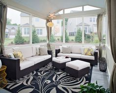 , Cool Modern Enclosed Patios With Black Plait Furnitures Set Like Couch And Footstool Also Antique White Fabrics Color Also Light Brown And White Cushions Also Elegant Black And White Carpet With Floral Pattern: Enclosed Patio and Enclosed Porch Designs