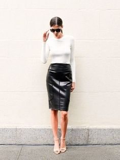 simple white T tucked in to leather pencil skirt.