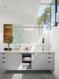 Subway tiles and double vanity in Palma Residence in Austin Texas by Hugh Jefferson Randolph Architects, Photograph by Casey Dunn | Remodelista