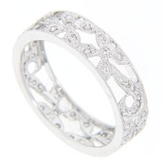 An openwork floral design decorated with diamonds wraps around the circumference of this 18K white gold antique style wedding band. The ring measures 5.25mm in width. Size: 6 3/4. Cannot be resized.