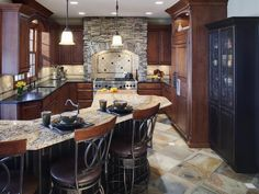 Kitchen with stone around the oven, breakfast bar, and island