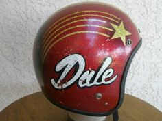Dale red metalflake helmet with gold shooting star Bobber Helmets, Motocross Helmets, Custom Motorcycle Helmets, Custom Helmets, Racing Helmets, Motorcycle Accessories, Vintage Helmet, Vintage Racing, Baby Helmet