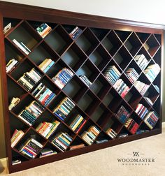 Diagonal bookcase - not your average home office bookcase! Woodmaster Woodworks offers free in-home estimates locally to the Triangle area. Call us at (919) 554-3707! www.woodmasterwoodworks.com
