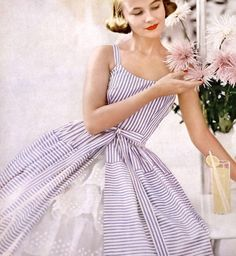 Ann Klem in lavender striped sun dress over organdy petticoat by Jack Horwitz, petticoat by Odette Barsa, photo by Lillian Bassman, Harper's Bazaar, January 1955 Fifties Fashion, Retro Fashion, Retro Outfits, Vintage Outfits, Vestidos Pin Up, Vintage Dresses 1960s, Look Retro, Vintage Fashion Photography, Estilo Retro