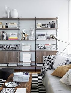 Whether your living room is large or small, a little extra storage will go a long way. Here are 11 fabulous living room storage ideas to hide away your clutter and still be stylish Interior Design Inspiration, Room Inspiration, String Shelf, Estilo Interior, Modular Shelving, Shelving Units, Shelving Decor, Wall Shelving, Modern Shelving