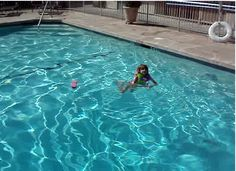 kid swims in big pool alone shes a swimmer enjoys it alot.