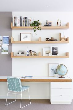 Love these minimalist shelves for an office.