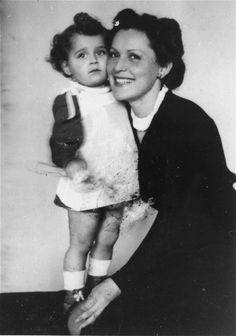 A Jewish child from Slovakia poses with the Hungarian woman who hid her in Budapest during the last six months of the war. 1944-1945.