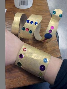 Domain 4 ancient civilizations: Cardboard tubes turned into Egyptian Cuffs.good way to do Egyptian art with Kindergarten! Egyptian Crafts, Egyptian Party, Egyptian Costume, Ancient Egypt Crafts, Egyptian Jewelry, Ancient Egypt Art For Kids, Ancient Egypt Activities, Greek Crafts, Party Mottos