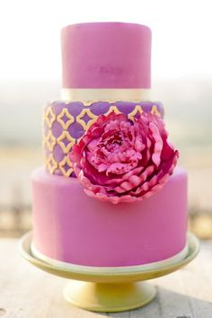 Fuchsia, purple and gold wedding cake