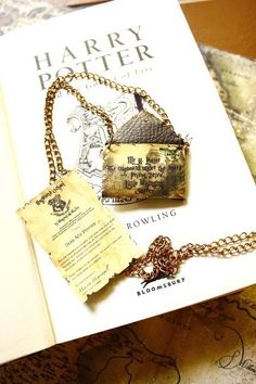 awesome necklace. link: http://www.etsy.com/listing/62451054/customisable-hogwarts-letter-necklace?ref=sc_2