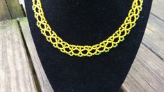 Check out this item in my Etsy shop https://www.etsy.com/listing/237117411/yellow-and-green-netted-bead-necklace